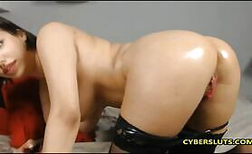 Beautiful Russian brunette oils her body for you